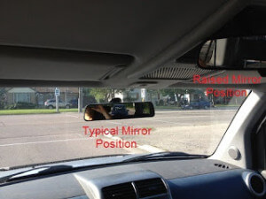 Raised rear view mirror for tall driver