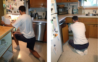 Tall people working in kitchen kneeling at fridge and sitting at stove