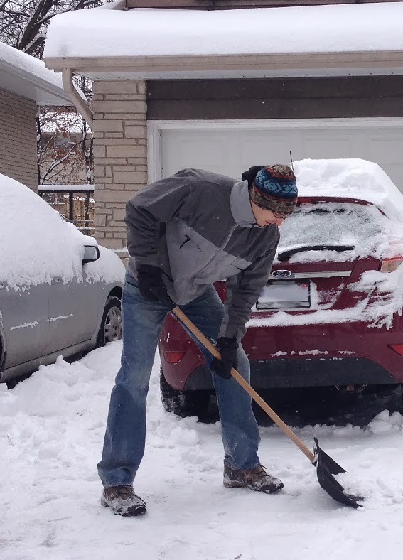 Tall Man needs extra long snow shovel for tall people