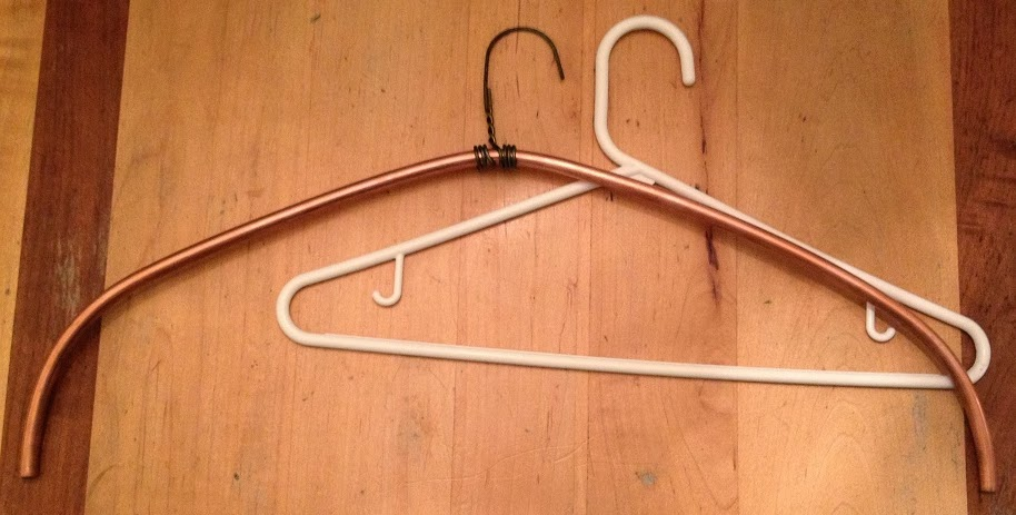 Extra wide clothes hanger compared to narrow hanger