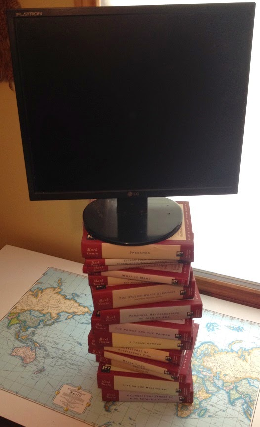 office desks for tall people. raising monitor for tall people with stack of books office desks o