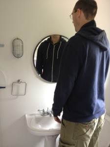 Tall People Can't See Themselves in Bathroom Mirrors