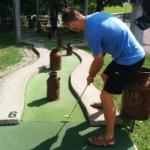 Tall Guy Playing Mini Golf