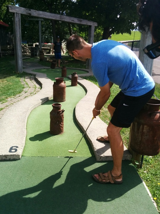 Tall Guy Playing Mini Golf
